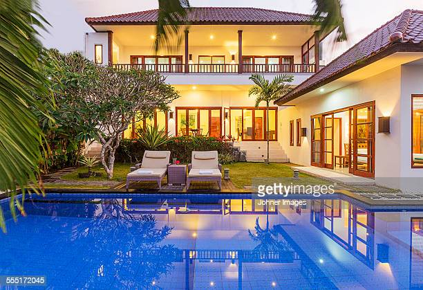 House with swimming pool at dusk