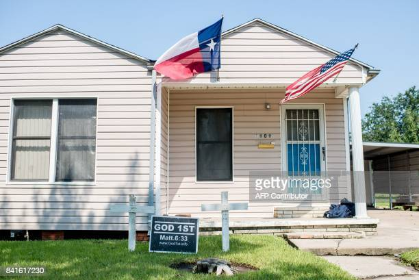 A house with the US and Texas state flag is seen in Port Arthur Texas on September 1 2017 Houston was limping back to life on Friday one week after...