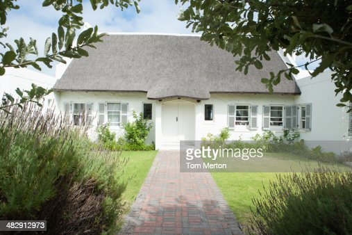 House with wooden fence  : Stock Photo