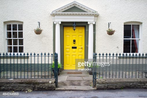 House with yellow door : Stock Photo