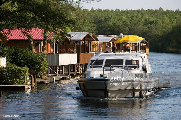 Houseboat and lakeside holiday homes, Muritz-Havel-Wasserstrasse Waterway, near Mirow, Mecklenburgian Lake District.