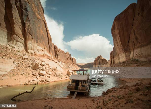 A Houseboat Parked in the Calm Waters of Escalante Canyon in Lake Powell