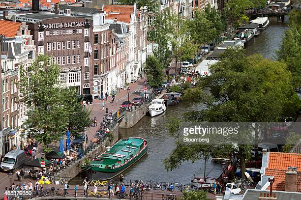 A houseboat sits moored in a canal in Amsterdam Netherlands on Wednesday Aug 26 2015 Seven years after a global financial crisis was sparked by lax...