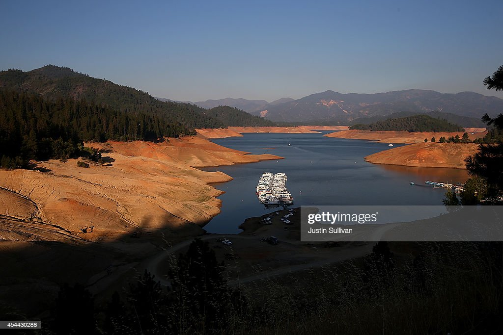 Houseboats are dwarfed by the steep banks of Shasta Lake at Bridge Bay Resort on August 31 2014 in Redding California As the severe drought in...