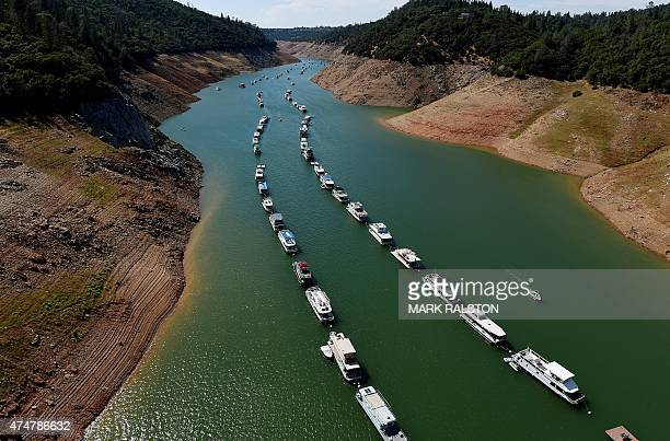 Houseboats are moored on a shrinking arm of the Oroville Lake reservoir which is now at 25 percent capacity as a severe drought continues to affect...