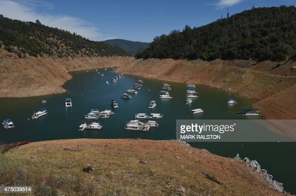 Houseboats are moored on a shrinking arm of the Oroville Lake reservoir which is now at less than 25 percent capacity as a severe drought continues...