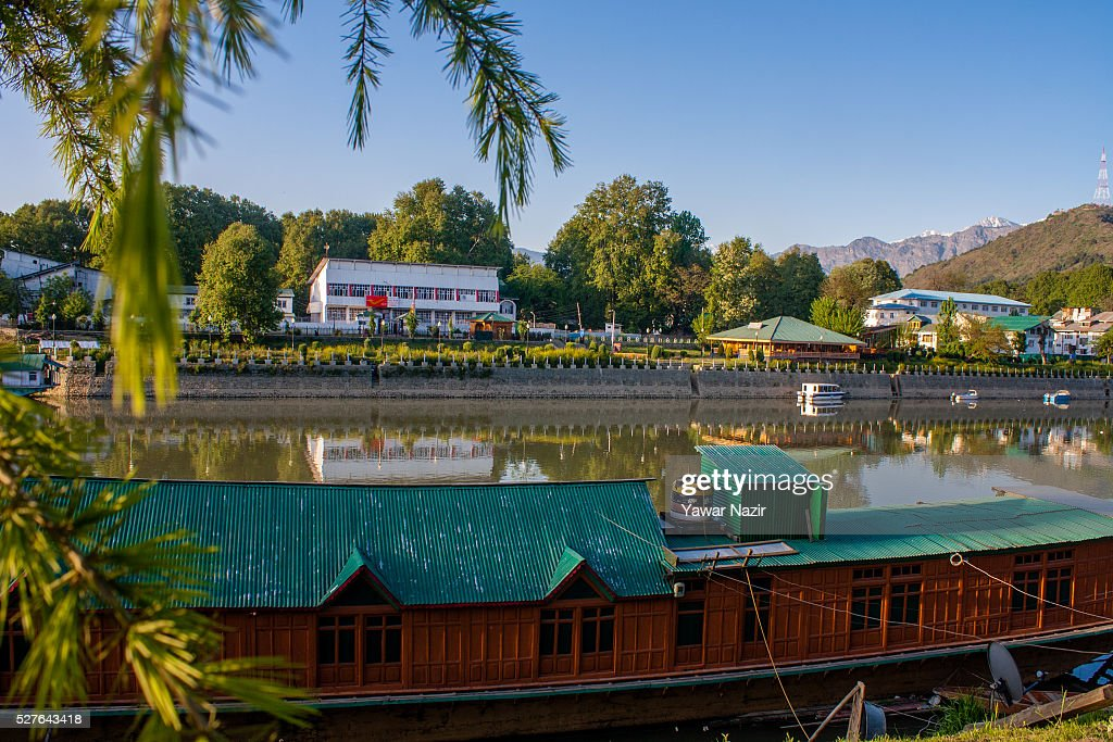 Houseboats are moored to the bank as river Jehlum on May 03, 2016 Srinagar, the summer capital of Indian administered Kashmir, India. Kashmir the Muslim majority state , is known as the 'Paradise on Earth' and has for centuries captured the imagination of many writers, poets and film makers and is integral to the tourist trade. Kashmir has been a contested land between nuclear neighbors India and Pakistan since 1947, the year both the countries attained freedom from the British rule.