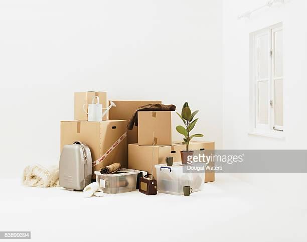 Household belongings in white room.