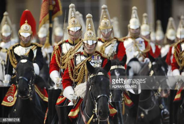 Household cavalry ride along The Mall towards Buckingham Palace while escorting The Queen following the State Opening of Parliament in London on...