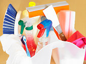 Household cleaning products in two white plastic containers