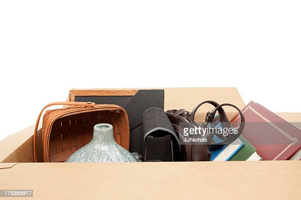 Household Items in Cardboard Box: Relocation or Yard Sale