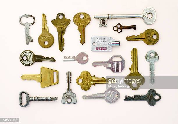 Household keys arranged in a rectangular pattern on a neutral background