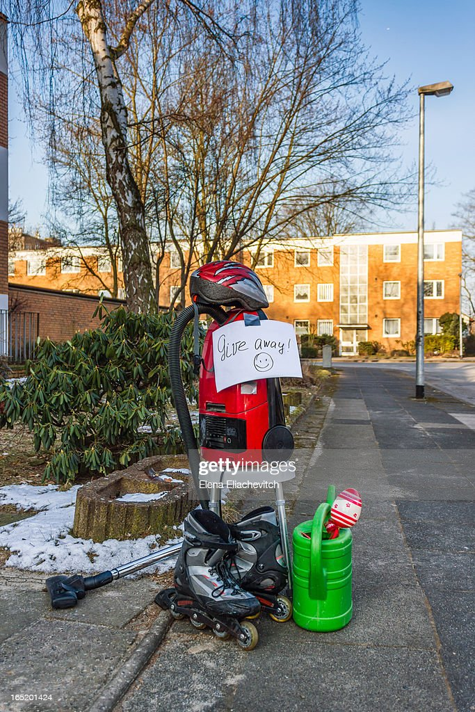 household objects in front of home with sign enc : Stock Photo