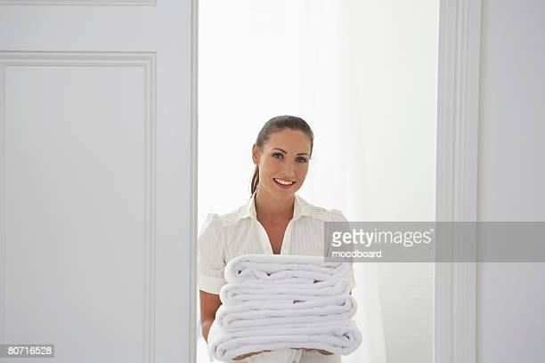 Housekeeper Bringing Towels