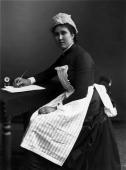 A housemaid at her writing desk