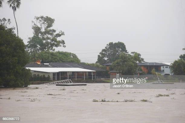 Houses along the tweed river as flood waters rise on March 30 2017 in Murwillumbah Australia Heavy rain and flash flooding is expected in south east...