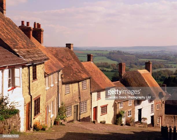 Houses and cobblestone street on hillside