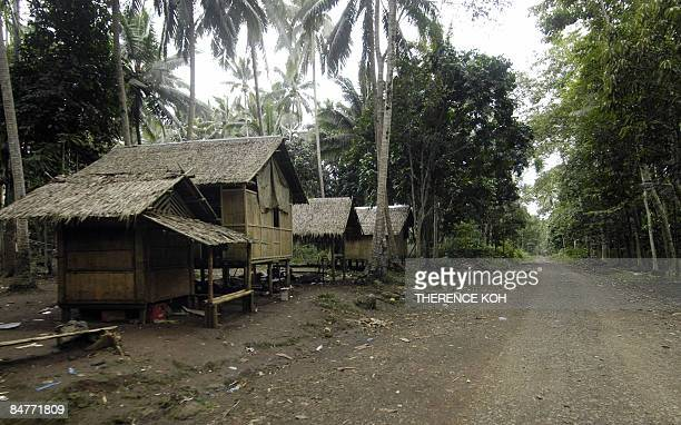 Houses are abandoned in a village in Indanan town in southern Jolo island on February 12 2009 Civilians have been ushered out of the area where...
