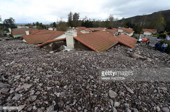 Houses are damaged on San Como Lane after heavy rain triggered a mudslide following a storm in the Camarillo Springs area of Ventura County...