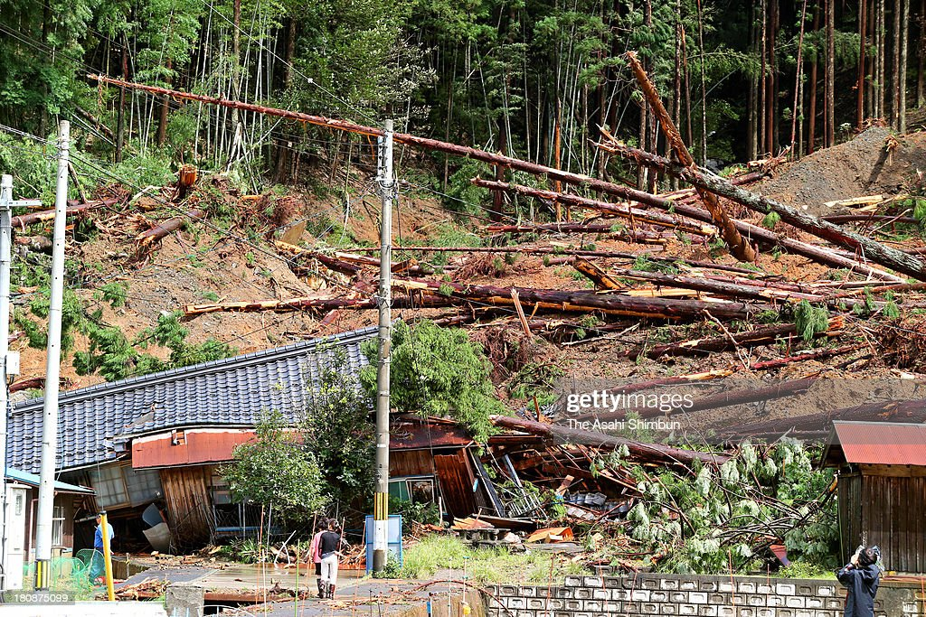 Houses are destroyed by a landslide triggered by typhoon Man-Yi approaching on September 16, 2013 in Obama, Fukui, Japan. The storm hit land near Toyohashi, Aichi Prefecture, before 8 a.m. and moved along Honshu throughout the day, damaging buildings, disrupting transportation and causing blackouts, three killed and five missing.