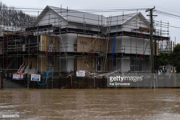 Houses are seen as rising waters cause flooding in Fifield Terrace in the suburb of Opawa on July 22 2017 in Christchurch New Zealand Heavy rain...