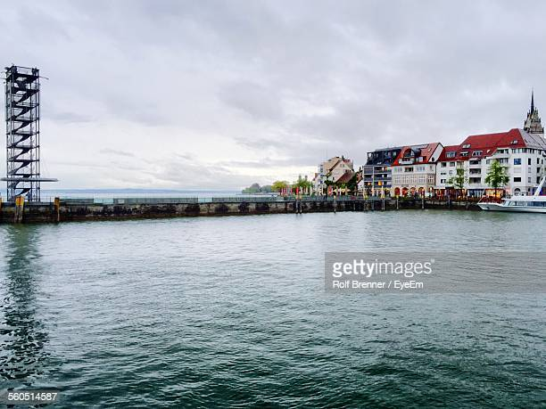 Houses At Seaside Against Cloudy Sky