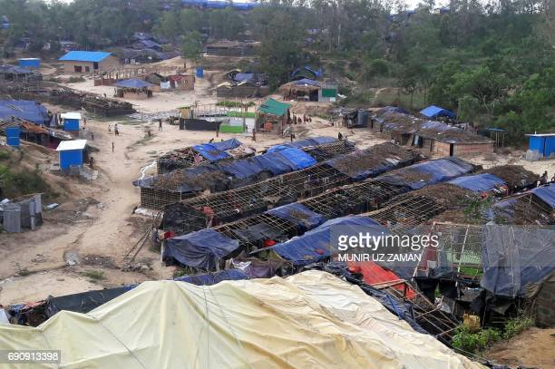 Houses belonging to Rohingya refugees and damaged by Cyclone Mora are seen at a camp in the Cox's Bazar district on May 31 2017 Aid workers warned...