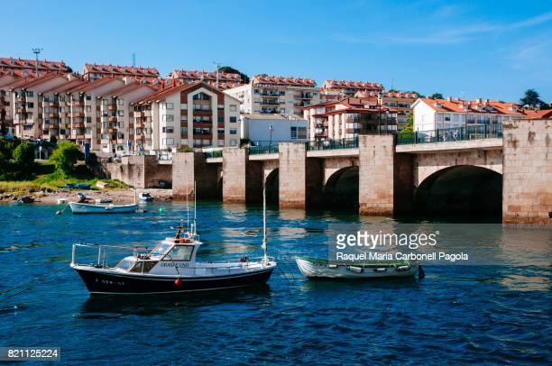 Houses bridge and boats on the sea