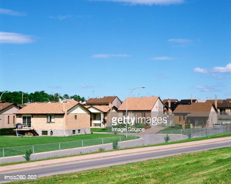 Houses by road : Stock Photo