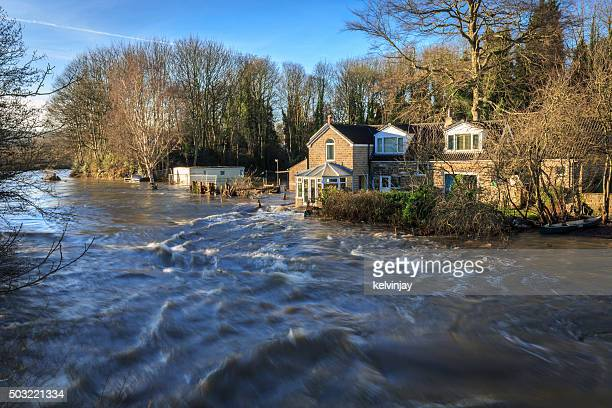 Houses by the river Aire in Leeds during a flood