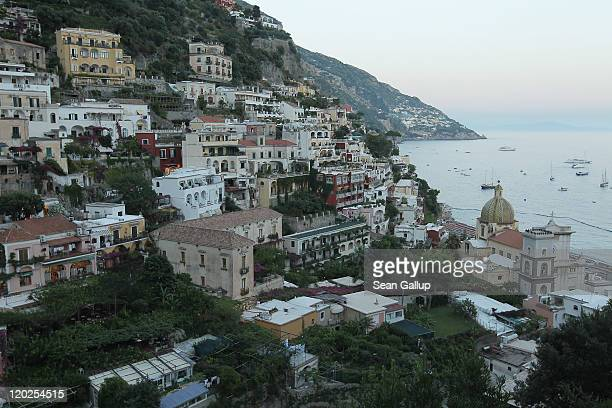 Houses cling to cliffs over the town center on July 27 2011 in Positano Italy The Amalfi coastline is among Italy's most popular tourist destinations