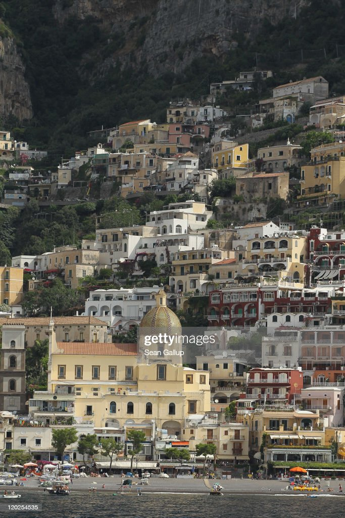 Houses cling to rocks over the town center on July 28, 2011 in Positano, Italy. The Amalfi coastline is among Italy's most popular tourist destinations.