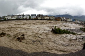 Houses damaged along the edge of Cougar Creek are shown June 20 2013 in Canmore Alberta Canada Widespread flooding caused by torrential rains washed...