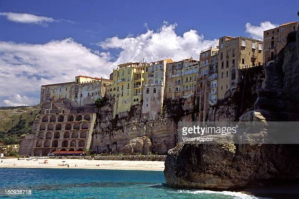 Houses facing sandy beach in Tropea