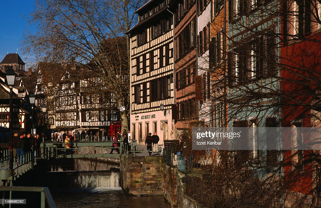Houses hug the banks of a canal in the so-called Petite France - Strasbourg, Alsace