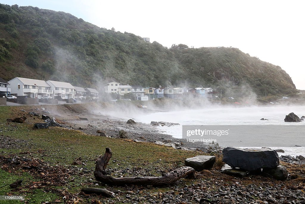 Houses in Lyall Bay are battered by sea spray during a large storm on June 21, 2013 in Wellington, New Zealand. Winds reached up to 200km per hour during the storm and around 30,000 homes were left without power across the Wellington region.