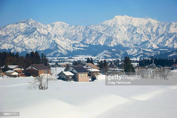 Houses in the snow before the Japan Alps