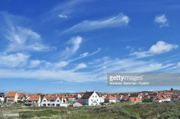 Houses In Town Against Blue Sky