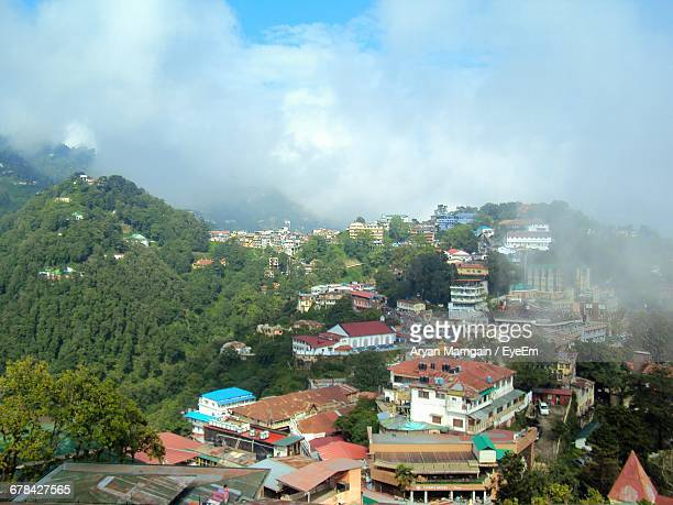 Houses In Town At Mussoorie Against Sky