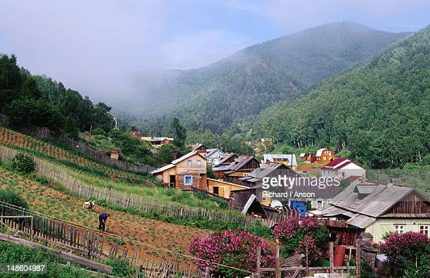 Houses in valley & villagers working in Garden in Listvyanka village on Lake  Baikal.