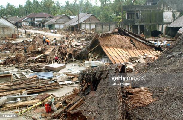 Houses lie destroyed at Sirombu village December 29 2004 in Nias North Sumatra Indonesia Tens of thousands of people have been killed in Indonesia's...