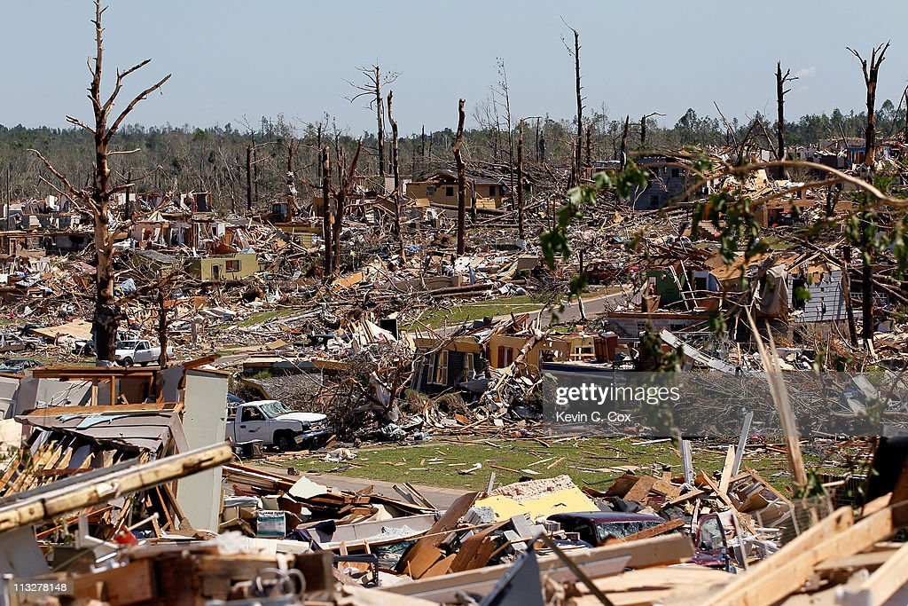 Houses lie in ruin amid vehicles and trees damaged by tornadoes on April 29, 2011 in Pratt City, Alabama. Alabama, the hardest-hit of six states, is reported to have had nearly 300 deaths as a result of the storms.