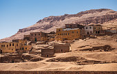 The old, ruined houses among cliffs and mountains of the desert of Egypt. Luxor, city of the dead (the West Bank)