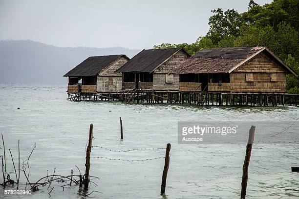 Houses on stilts over the sea Yenwaupnor village Pulau Gam Raja Ampat islands Papua Province Indonesia