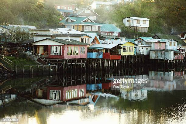 Houses on stilts over water