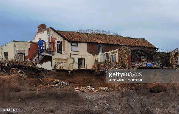 Houses on the East Coast close to Skipsea has been left teetering on the edge of the North Sea and will be lucky to last another year Owner Colin...