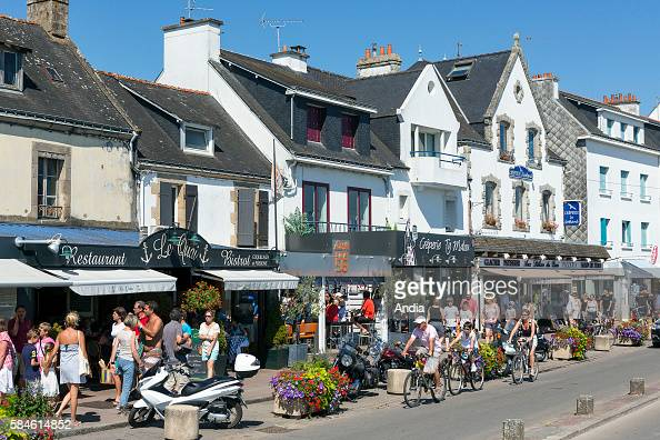 Houses on the seafront in La Trinite sur Mer Real estate and shops on the 'cours des Quais' along the marina