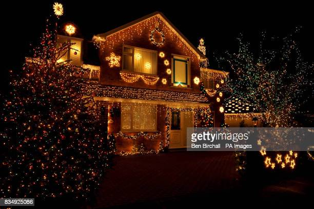 Houses on Trinity Close in Burnham on Sea Somerset are decked out with thousands of Christmas lights and garden decorations