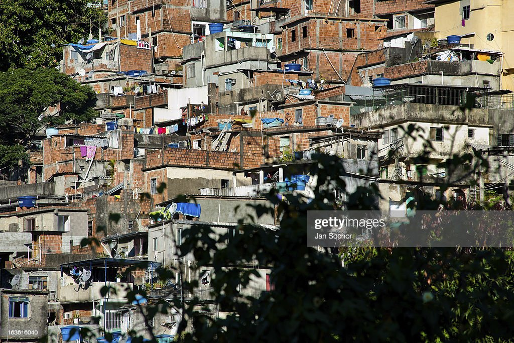 Houses seen on a steep hillside in the favela of Rocinha, on 20 February 2012 in Rio de Janeiro, Brazil. Rocinha, the largest shanty town in Brazil and one of the most developed in Latin America, has its own samba school called GRES Academicos da Rocinha. The Rocinha samba school is very loyal to its neighborhood. Throughout the year, the entire community actively participate in rehearsals, culture events and parades related to the carnival.