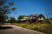 Houses sit abandoned on September 4 2013 in the Six Mile Gratiot neighborhood of Detroit Michigan Detroit has an estimated 78000 abandoned buildings...